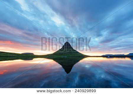 Colorful sunrise on Kirkjufellsfoss waterfall. Amazing morning scene near Kirkjufell volkano, Iceland, Europe. Landscape photography