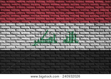 Iraq Flag Is Painted Onto An Old Brick Wall