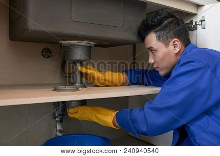 Plumber Changing Details Of Drain System In Kitchen