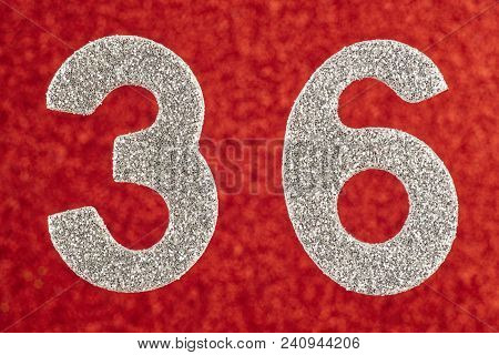 Number Thirty-six Silver Color Over A Red Background. Anniversary. Horizontal