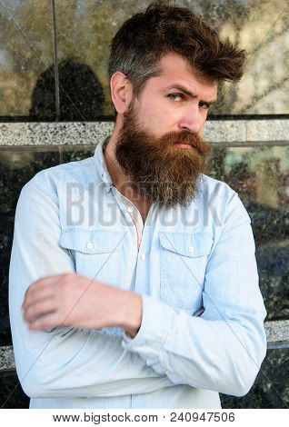 Masculinity Concept. Guy Looks Suspicious. Hipster With Tousled Hair Hold Arms Crossed On Chest. Man