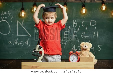 Child, Pupil On Calm Face With Mortarboard. Kid Boy In Graduate Cap Ready To Go To School, Chalkboar