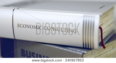 Book In The Pile With The Title On The Spine Economic Consulting. Close-up Of A Book With The Title