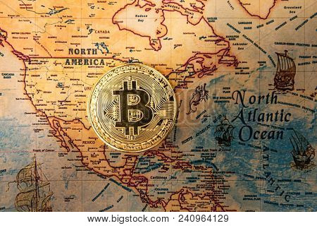 Digital currency concept - Crypto currency bitcoin on map of North America