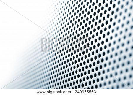 Abstract Steel Plate With Circle Holes, In Shifting Focus, Fading Into Absolute White