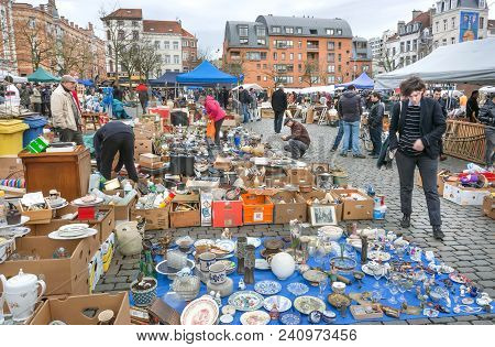 Brussels, Belgium - Apr 3: Customers Of Flea Market And Many Old Art, Bargains And Antique Stuff In