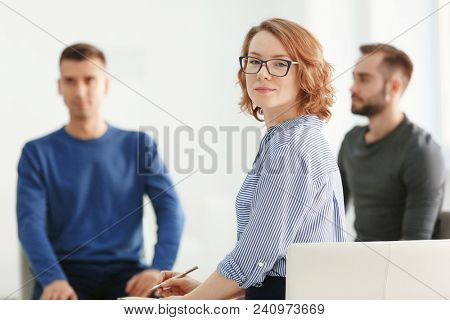 Female psychologist at group psychotherapy session indoors