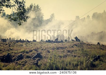 Silhouettes Of The Military In The Woods, Military Actions In The Open Air, Nature And Smoke