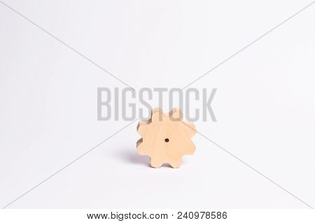 Wooden Gear On A White Background. Abstract Background For Presentations And Banners. The Concept Of