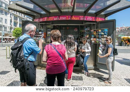 Lisbon, Portugal, May 5, 2018: A Few Tourists Stand In Line To An Information Booth On Rossio Square