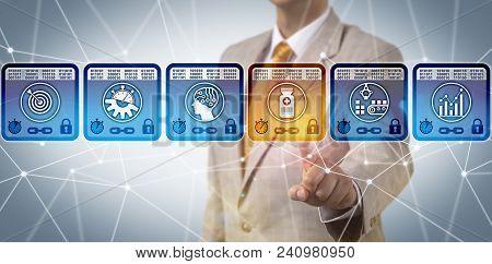 Unrecognizable Pharmaceutical Corporate Executive Managing Supply Chain Via Blockchain Interface. Ph