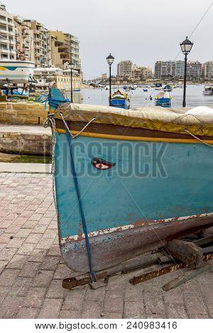 Traditional Maltese Fishing Boat On A Boat Ramp At Spinola Bay, St. Julian's, Malta