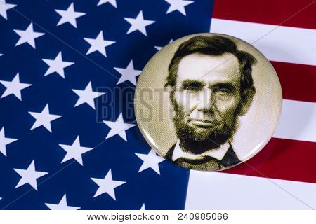 London, Uk - April 27th 2018: An Abraham Lincoln Badge Pictured Over The Usa Flag, On 27th April 201