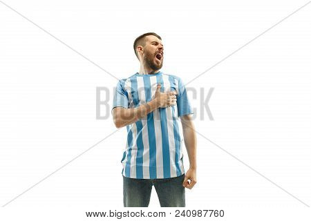 The Young Argentinean Fan Celebrating On White Background. The Young Man In Soccer Football Uniform