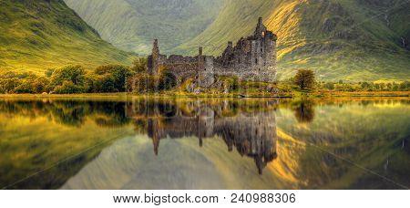 Kilchurn Castle Reflection In Loch Awe At Sunrise, Highlands, Scotland