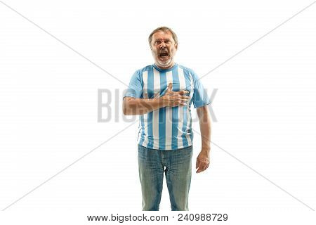 The Argentinean Fan Celebrating On White Background. The Senior Man In Soccer Football Uniform Singi