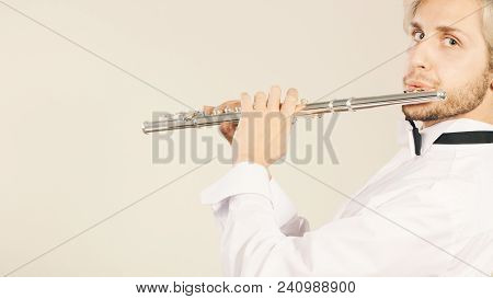 Flute Music Playing Professional Male Flutist Musician Performer. Young Elegant Stylish Man With Ins