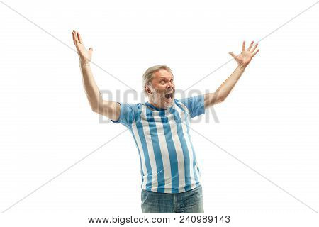 The Senior Argentinean Fan Celebrating On White Background. The Mature Man In Soccer Football Unifor