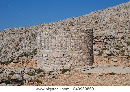 An old stone windmill on the high plateau of the Greek island of Halki.