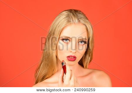 Blonde Girl With Lipstick In Hand. Advertising Lipstick, Lip Gloss, Professional Makeup. Beauty Face
