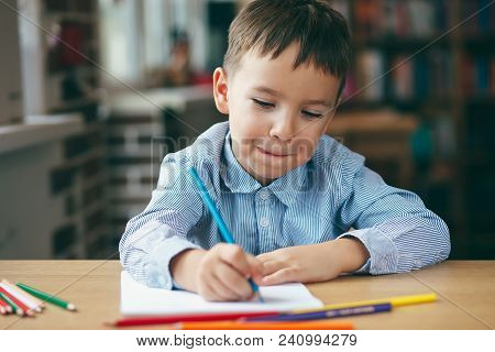 Cute  Smiling Boy Doing Homework,  Coloring Pages, Writing And Painting . Children Paint. Kids Draw.