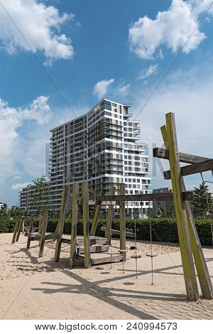 Frankfurt Am Main, Germany-may 11, 2018: Playground In Front Of Residential Building In A New Distri