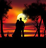Two lovers on the beach with tropical sunset palms sea and island behind them poster