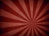 An Aged Star Burst Pattern In Red Colour poster