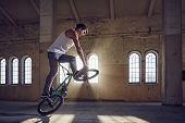 BMX stunts in a sunray indoor gothic hall. poster