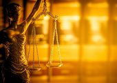 Legal law concept image, scales of justice lit by golden light. poster