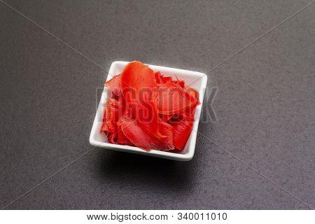 Pickled Sushi Ginger Slices In White Bowl On Stone Background