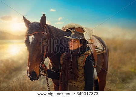 Young Beautiful Dreadded Girl Outdoors With Her True Horse.