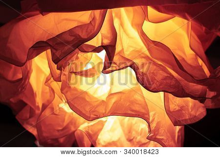 Abstract Defocus Background Orange Backdrop, Crumpled Paper Lit By A Lamp. Color Of The Year 2020 La