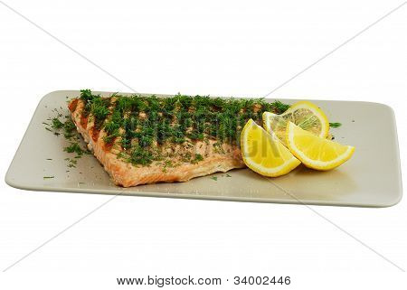 Grilled Salmon Fish Fillet With Dill And Lemon On Grey Ceramic Dish