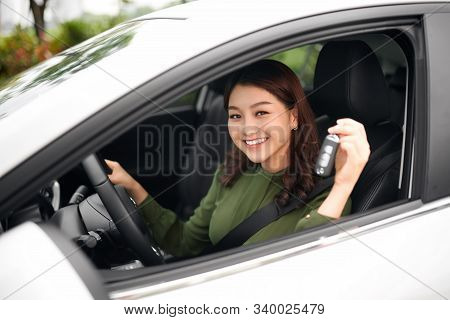 Young Happy Woman Driver Hold Car Keys In Her New Car