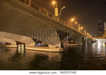The bridge over the river at night above has bright lights to illuminate the road.