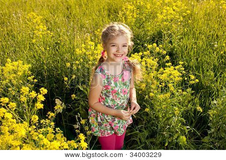 Funny little girl among yellow wildflowers in the summer poster