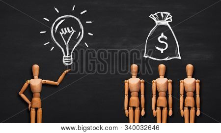 Conceptual Image Of Wooden Man Holding Light Bulb And Group Of People With Money Baggage Above, Crea