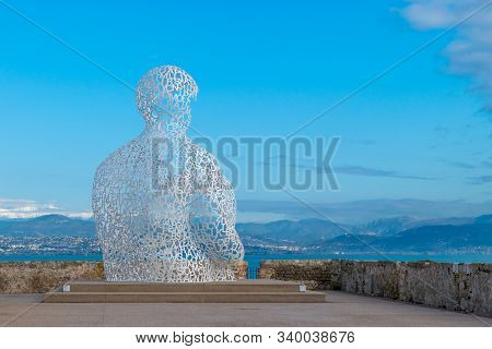 Antibes France 6 Dec 2019 Le Nomade Sculpture From The Spanish Artist Jaume Plensa In The Background