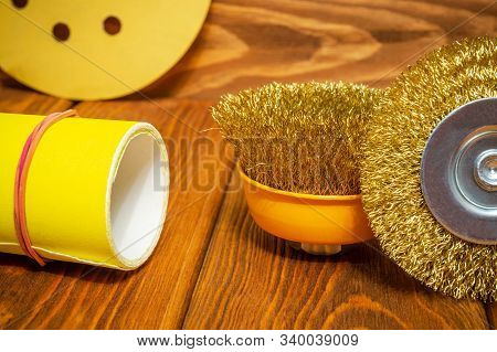 Set of abrasive tools and yellow sandpaper on vintage wooden background wizard is used for grinding items poster