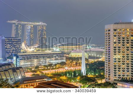 Singapore Hdb Building Complex And Downtown Skylines Illuminated In Blue Hour