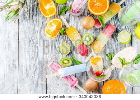 Colorful Fruit Ice Cream Popsicle. Juicy Gelato Lollypops On Sticks, With Different Fresh Tropic Fru