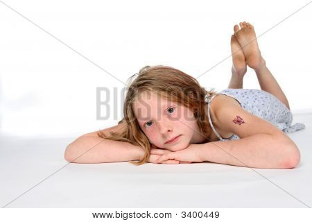Thoughtful Girl On Stomach