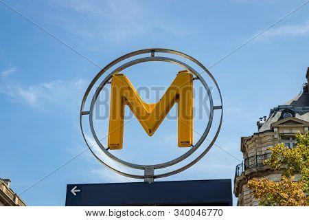 Circular Orange Metro Sign In Paris France