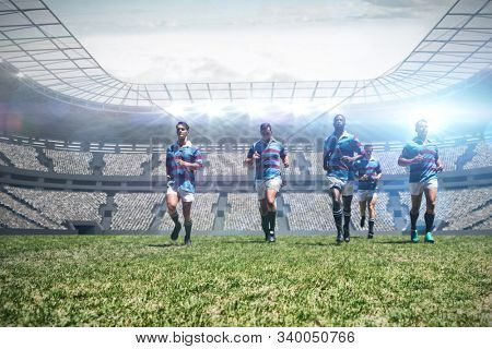 Rugby players against rugby stadium