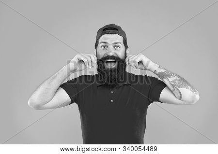 Tips For Growing And Maintaining Moustache. Cool And Stylish. Man Bearded Hipster Twisting Mustache