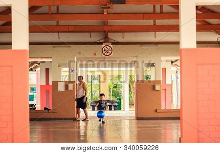 Singapore-05 Oct 2019:child Play In Hdb Residential Function Room Open Space