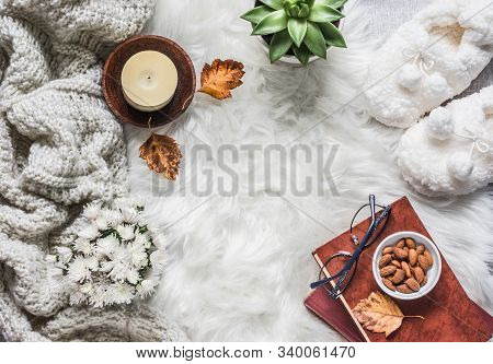 Flat Lay Cozy Home Still Life - Stack Of Books, Knitted Plaid, Candle, Chrysanthemum Bouquet, Fur Ca