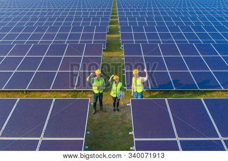 Aerial View Of Engineer Or Worker, People, With Solar Panels Or Solar Cells On The Roof In Farm. Pow