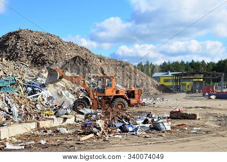 Front-end Loader Works In A Landfill For The Disposal Of Construction Waste And Other Debris. Indust